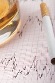 foto of ecg chart  - Glass Of Whiskey And Cigarette On ECG Printout - JPG