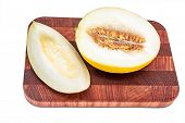 image of honeydew melon  - Honeydew melon on cutting board isolated over white background - JPG