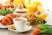 stock photo of buffet  - Breakfast with coffee juice croissant salad muesli and egg - JPG