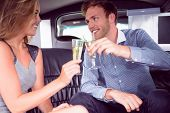 pic of limousine  - Happy couple drinking champagne in limousine on a night out - JPG