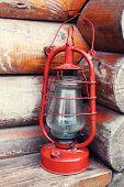 pic of kerosene lamp  - Kerosene lamp on wooden hose background - JPG