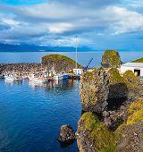 stock photo of fjord  - White fishing boat in the harbor pier village Arnastapi - JPG
