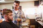 picture of barber  - Male Barber Giving Client Haircut In Shop - JPG
