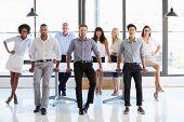 pic of coworkers  - Coworkers posing to camera in meeting room - JPG