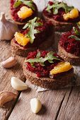 stock photo of canapes  - Canape with beets oranges and arugula close - JPG