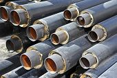 foto of insulator  - Steel pipe with heat insulation on construction site - JPG