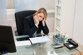 picture of employee month  - Portrait Of Stressed Businesswoman Sitting At Desk With Gantt Progress Chart - JPG