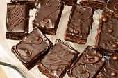 stock photo of icing  - Cakes with chocolate icing with side light - JPG