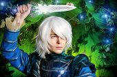foto of elf  - Beautiful blond elf with a dagger in his hand in the magic forest - JPG