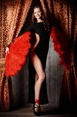 foto of cabaret  - Beautiful dancer on the stage of cabaret - JPG