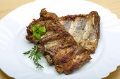 stock photo of roasted pork  - Roasted pork ribs with herbs and spices - JPG