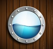 stock photo of oceanography  - Round porthole on a wooden surface - JPG