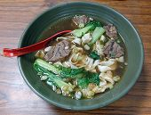 stock photo of chive  - Braised chunks of beef in broth with noodles and chives is a popular dish in Taiwan - JPG