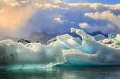 pic of iceberg  - Icebergs floating in Jokulsarlon Lagoon by the southern coast of Iceland - JPG
