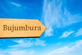 picture of burundi  - Wooden arrow sign pointing destination BUJUMBURA BURUNDI against clear blue sky with copy space available - JPG