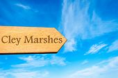 image of marshes  - Wooden arrow sign pointing destination CLEY MARSHES ENGLAND against clear blue sky with copy space available - JPG