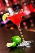 foto of cosmopolitan  - Cosmopolitan cocktail shot on a bar counter in a night club - JPG