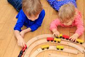 stock photo of daycare  - kids playing with railroad and trains indoor - JPG