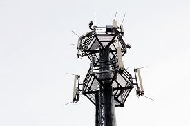 image of telecommunications equipment  - telecommunication equipment on top of antenna tower - JPG