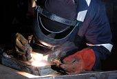 picture of tig  - TIG welder uses torch to make sparks during manufacture of metal equipment - JPG