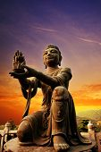 stock photo of lantau island  - Buddhistic statue praising and making offerings to the Tian Tan Buddha  - JPG