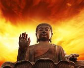 Statue of Buddha over yellow sky