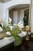 picture of flower vase  - a vase full of cala lilies in a home interior - JPG