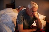 Worried Senior Man In Bed At Night Suffering With Insomnia poster