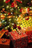 picture of christmas-present  - Wrapped gifts under a decorated Christmas tree - JPG