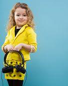 Cute Young Girl In Earphones poster
