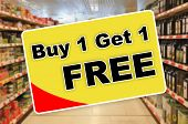 Buy One Get One Free Yellow Label On An Abstract Supermarket Background poster