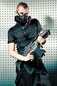 picture of skinhead  - Shot of a conceptual man in a respirator holding a gun - JPG