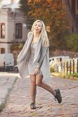 Young Stylish Woman Walking On The City Street poster