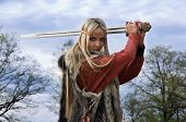 image of viking  - Viking girl warrior with sword in a wood - JPG