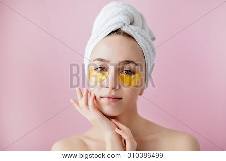 poster of Portrait Of Beauty Woman With Eye Patches On Pink Background. Woman Beauty Face With Mask Under Eyes