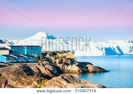poster of Shore Of Atlantic Ocean With Icebergs In Ilulissat Town At Sunrise, Western Greenland.