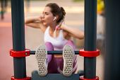 Young Woman Is Training On The Outdoors Playground. Gym Open Air Fitness Workout Outdoor Concept. Pr poster