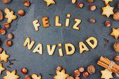 Feliz Navidad Cookies. Words Merry Christmas En Spanish With Baked Cookies, Christmas Decoration And poster