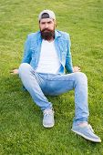 Keeping It Casual. Bearded Man In Casual And Comfy Outfit Sitting On Green Grass. Hipster In Casual  poster
