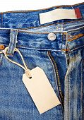 picture of hackney  - unbuttoned blue jeans with paper label isolated on white background - JPG