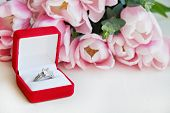 Close Up Composition With Luxurious Diamond Ring And Beautiful Bouquet Of Pink Tulips. poster