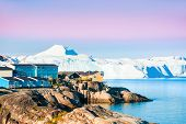 Shore Of Atlantic Ocean With Icebergs In Ilulissat Town At Sunrise, Western Greenland. poster