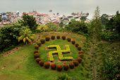 image of swastika  - buddhist swastika topiary in Sandakan Sabah Borneo Malaysia  - JPG