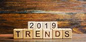 Wooden Blocks With The Word Trends 2019. Main Trend Of Changing Something. Popular And Relevant Topi poster