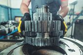 Planetary Gear Replacement By Caucasian Heavy Duty Machinery Technician. Industrial Theme. Complex R poster