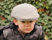 young boy wearing a flat cap