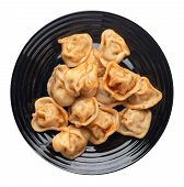 Dumplings On A Black  Plate Isolated On White Background. Dumplings In Tomato Sauce. Dumplings Top V poster