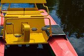 Beautiful Iron Red Water Catamaran Boat With Pedals For Sailing On The Lake River To The Sea On Holi poster