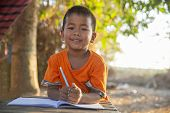 Asian Child (poor Kids) Study At Old Home.asia Boy Learning To Drawing,painting With Color Pencil. P poster