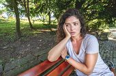 Young Girl Or Woman Sitting Alone On The Park Bench Feeling Depressed And Sad After She Had Argue An poster